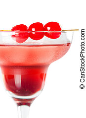 Red tropical cocktail with cherry