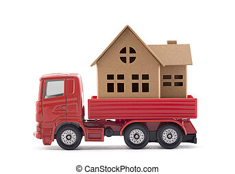 Red truck miniature with house on white background