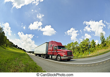 Horizontal fish eye lens view of a Red Semi Truck On an Interstate Highway.