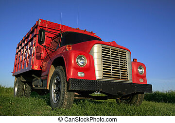 Red truck with blue sky background wide angle photo