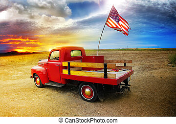 Red Truck - Red vintage pick up truck with American flag in...