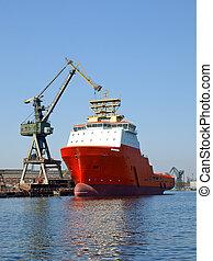 Red tug in shipyard