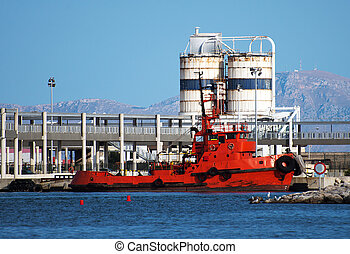 Red tugboat in the port.