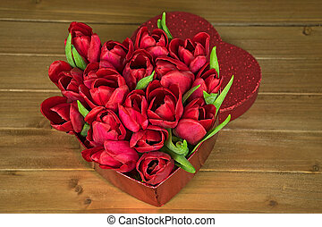 red tulip bouquet in heart box