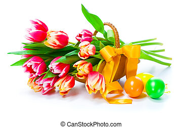 red tulips flowers with Easter eggs, on a white background.