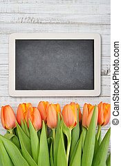 Red tulips with chalkboard