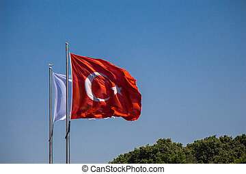 Turkish flag with blue sky on the background