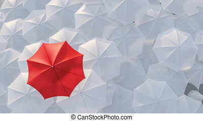 Red umbrella standing out from crowd mass concept
