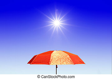 red umbrella under bright sun