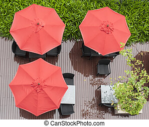 red umbrellas and chairs