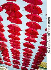 Red umbrellas sky