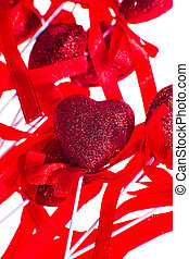 Red valentine heart shaped decorations with ribbon and bows isolated over white background.