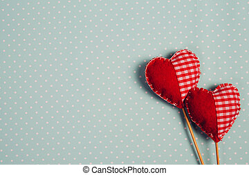 Red valentine hearts on pastel blue background