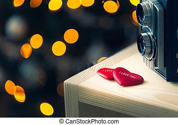 red valentines heart with old camera and bokeh - red...