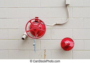 Red Valve on White Wall