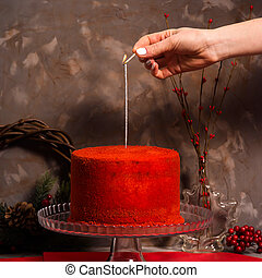 Red velvet cake with cream cheese on a gray background