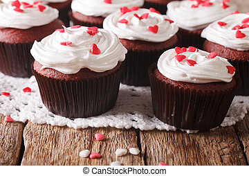 red velvet cupcakes decorated with hearts close-up. Horizontal
