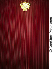 Red velvet curtain with old fashioned lamp