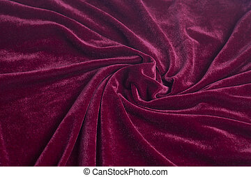 Red velvet fabric with spiral folds