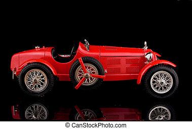 red vintage car on black background