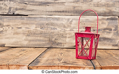 red vintage lamp on rustic wooden table