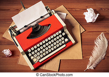 Red vintage typewriter with white blank paper sheet