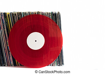 Red vinyl records on a white background