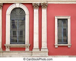 Red wall and ornate windows