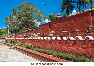 Red wall in the complex Pashupatinath Temple, Nepal. - Red...