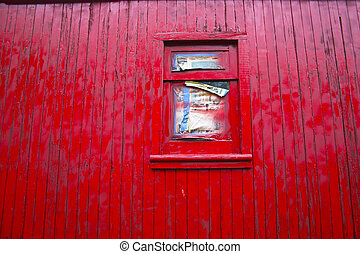 Red wall with window - Red wall of a caboose with newspaper-...