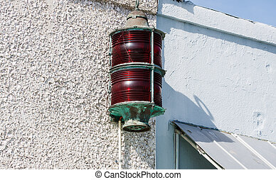 Red Warning Beacon on White Plaster Wall