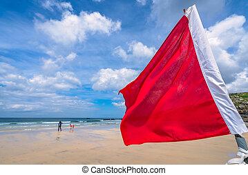 Red warning flag on Cornish beach