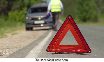 Insector Going To A Car With An Emergency Stop - Red Warning...