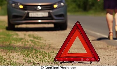 Warning Triangle Stands On The Road