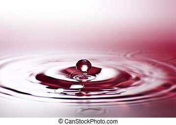 Red water environmental abstract background - red water drop splashing in clear clean water