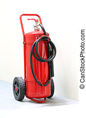 red wheeled fire extinguisher with black pipe