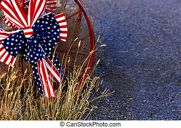 Red, white and blue bow on metal wheel - A red, white and...