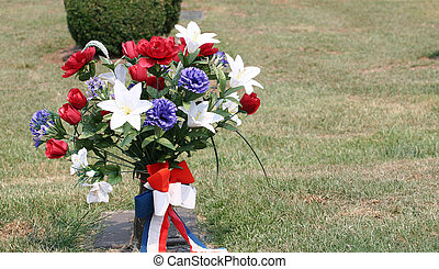 Red White and Blue Flowers at a grave site