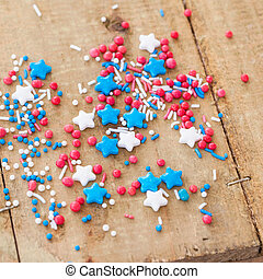 Red, white and blue sprinkles on rustic wooden background
