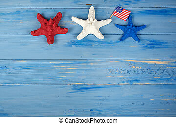 red white and blue starfish on wood