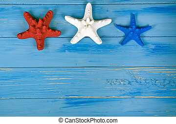 red white and blue starfish on wood - red white and blue...
