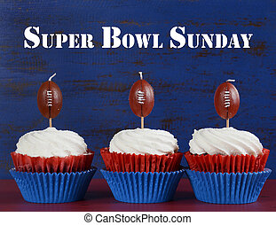 Red, white and blue theme cupcakes with football toppers for...