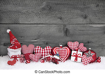 Red white checked christmas decoration on grey wooden background