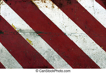 Red and white diagonal grunge paint strips on steel panel surface