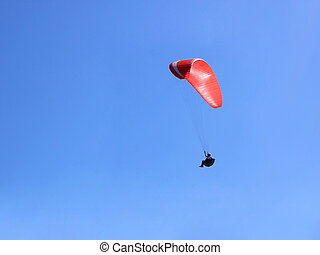 Red-white paraglider
