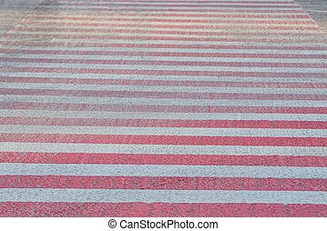 red white texture of the stripes on the road at the pedestrian crossing