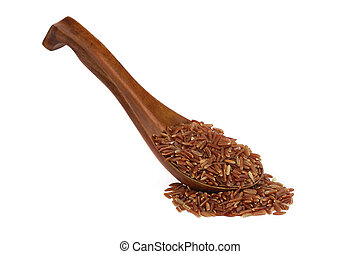 Red whole wheat rice on a wooden spoon against white background