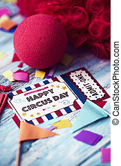 red wig, clown nose and text happy circus day
