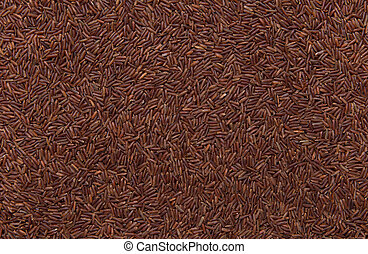 red wild rice as background, close up of grains