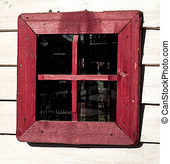 Red window of a old wooden house